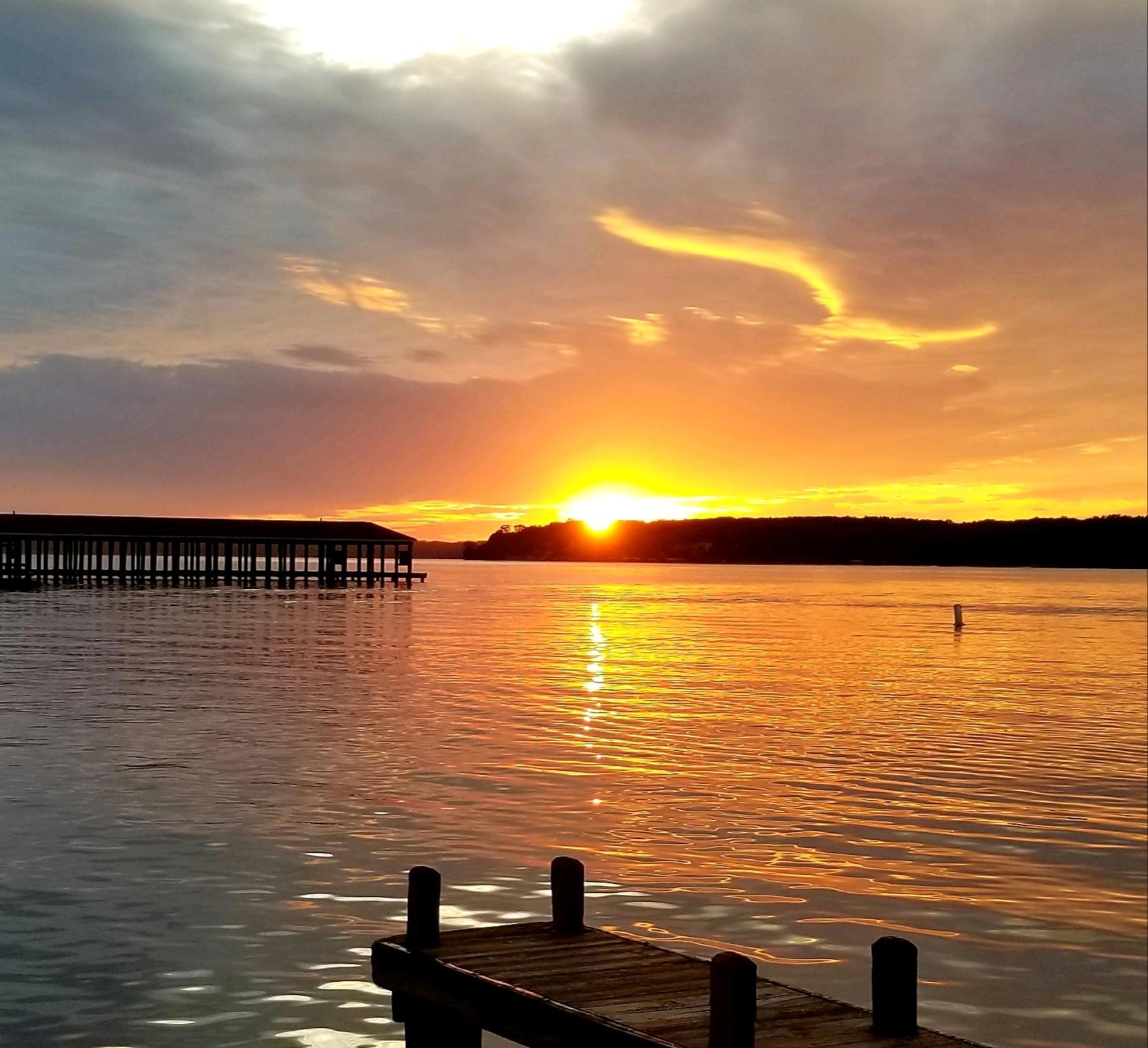 sunset over docks on lake Gaston