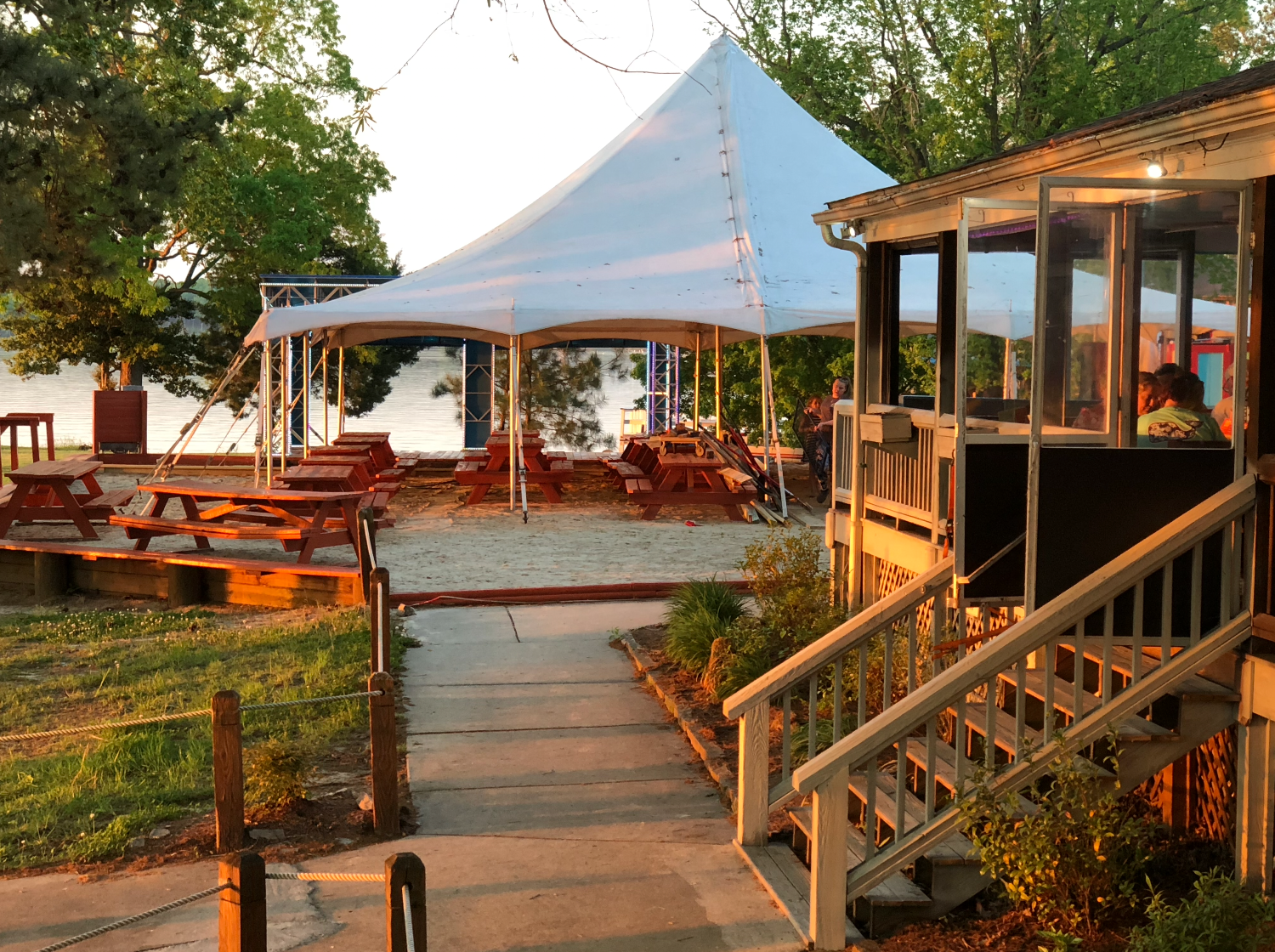 event tent and tables on lake Gaston